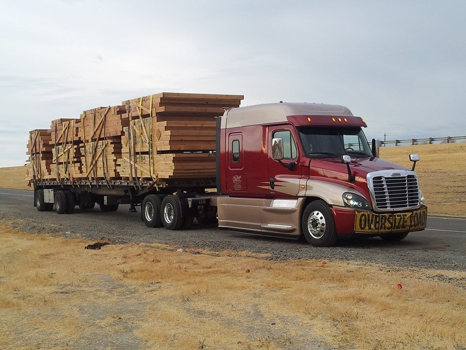 Flatbed Trailer hauling lumber and building materials