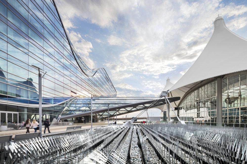 "<img src=""studioINSITE_WestinDEN_Plaza_Artistic Element""alt=""Denver International Airport, DIA, Denver, CO, Colorado, Airport, Art, Hotel, Transit, Light Rail, Events, Arts, Sculpture, Plaza, Transportation, Terminal, Hub""title=""Denver International Airport - Westin Hotel Plaza""/>"