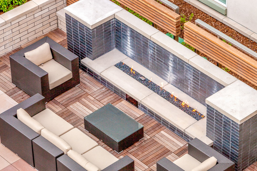 "<img src=""studioINSITE_Elan_Union_Station_Fireplace_Seating"" alt=""Urban Living, Multifamily, Mixed Use, Urban grocer, Streetscape, Courtyard, Amenity Deck, Fireplace, Grill area, shade structure, Cabanas, Fireplace, Boccee Court, Outdoor Bar, landscape Architecture, Urban Design, Denver, Colorado, Elan Union Station, Denver Union Station, Luxury Living, Luxury Apartments, Luxury Developments"" title=""Elan Union Station""/>"