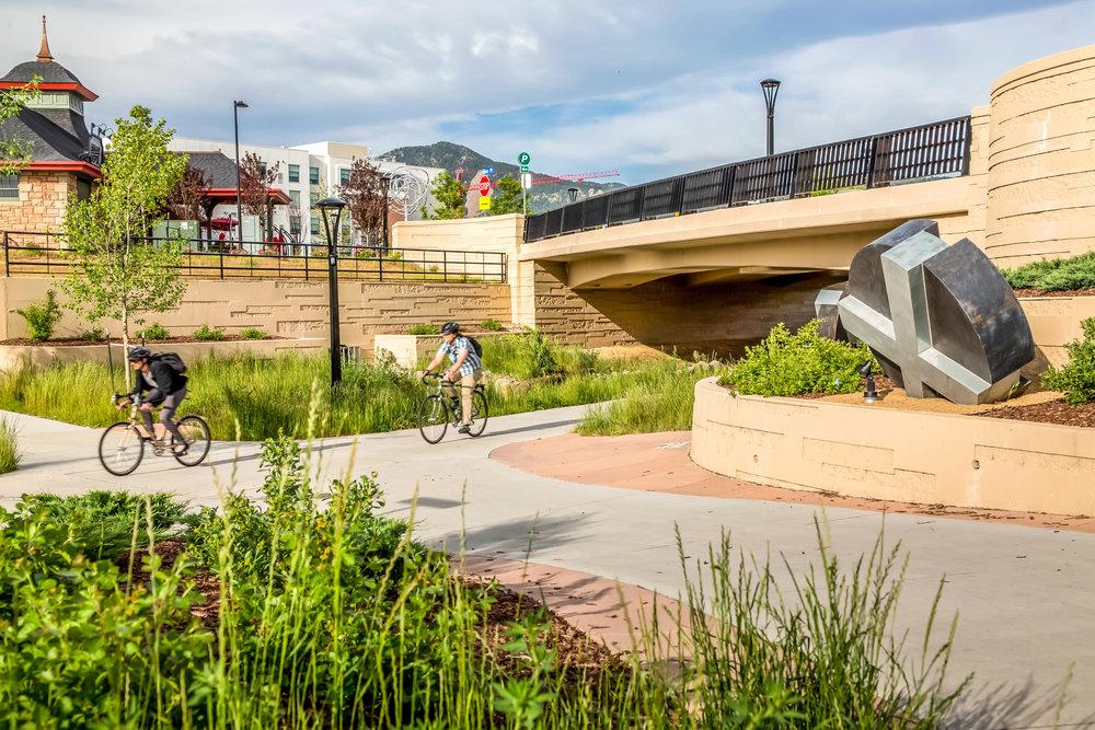 """<img src=""""studioINSITE_Boulder_Junction_Place_Greenway_2 bikers""""alt=""""Boulder, Junction Place, Bike Trails, Transite Depot, Bridge, Streetscape, Greenway, Landscape Art, Art, Public Outreach, Landscape Architecture, Urban Designtitle=""""Boulder Junction Place""""/>"""