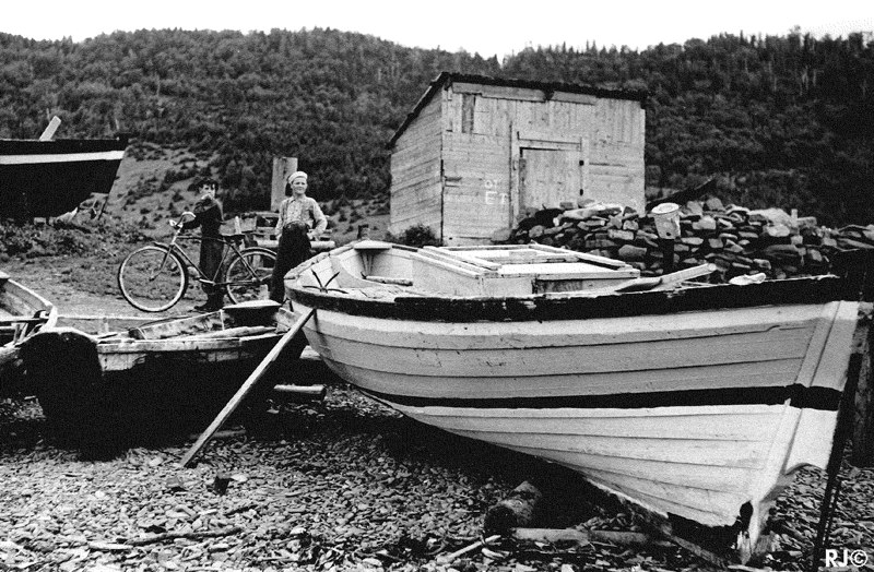 Girl near beached boat - Gaspé, 1954