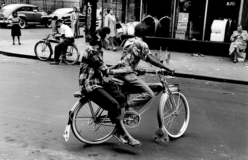 Girl on back of bicycle, Manhattan, 1954