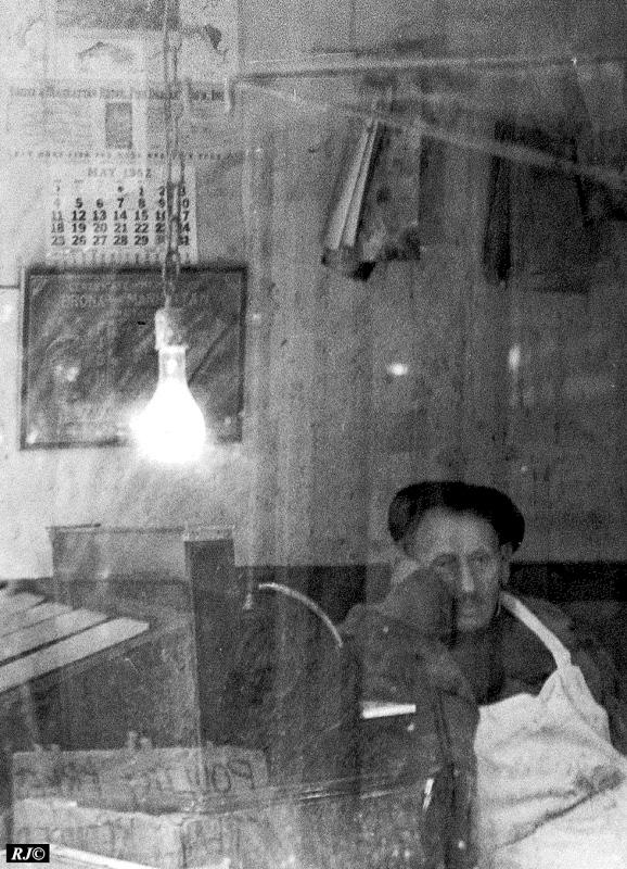 Lightbulb and man resting, Manhattan, 1952
