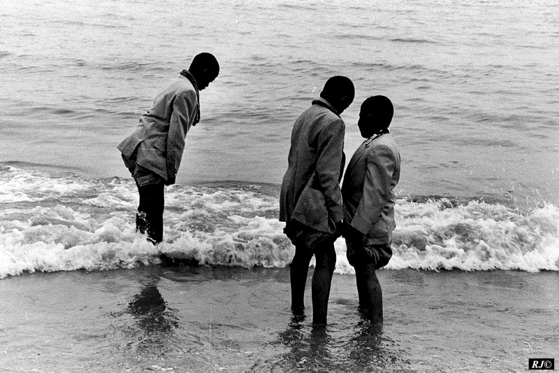 Three youths wading, Coney Island, 1953