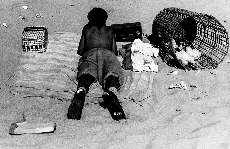 Sunbathing near garbage can, Coney Island, 1952