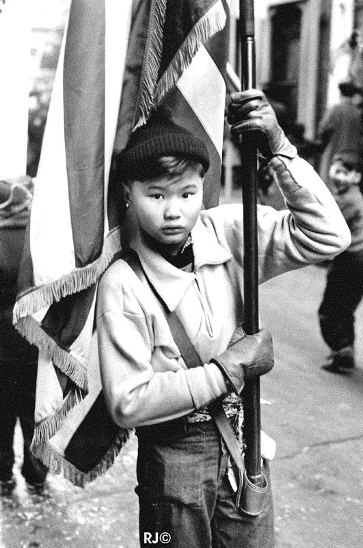 Boy holding flag, Chinese New Year, 1953