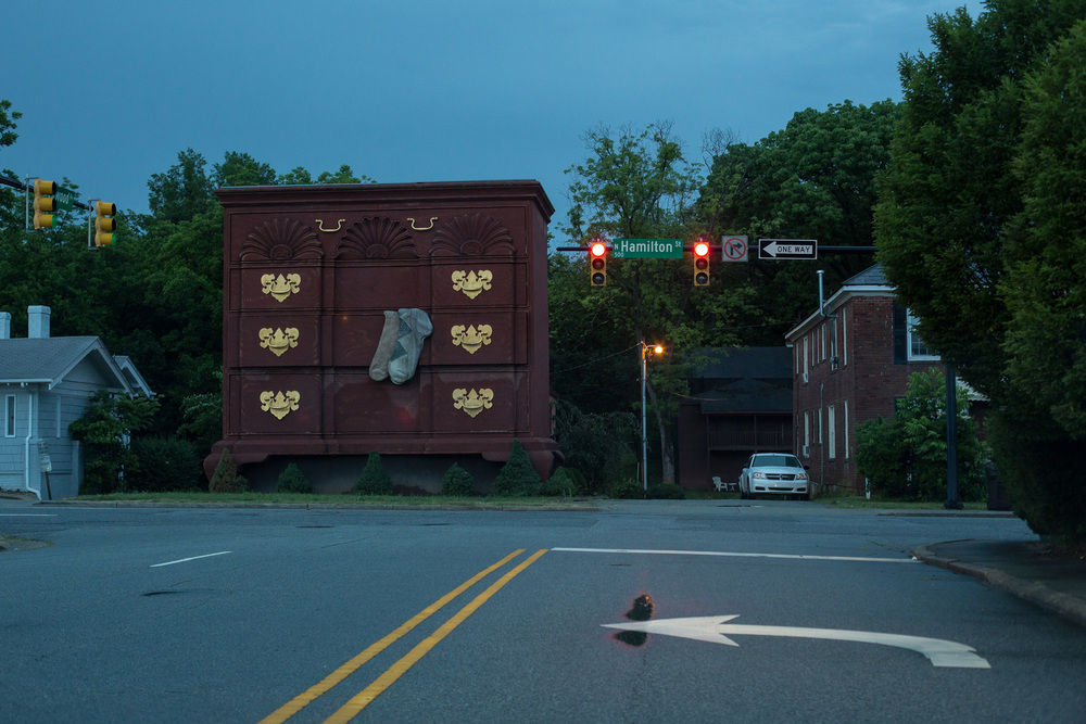 A giant dresser on Hamilton Street stands in homage to the furniture industry in downtown High Point, N.C. According to American Community Survey 2013 5-year estimates, 21 percent of High Point's 102,924 population lives in poverty, and 32 percent of children under 18 live in poverty.