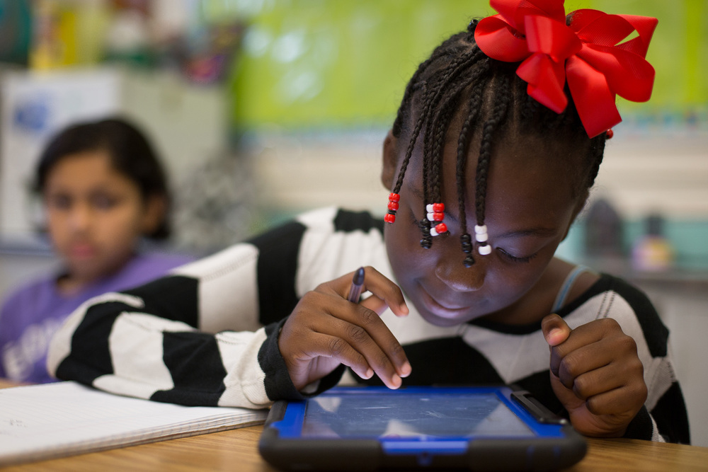 Donjana Wilson, 11, uses a tablet in Virginia Stanfield's 5th-grade math class. Federal grants have enabled each student to have access to tablets at the Parkview.