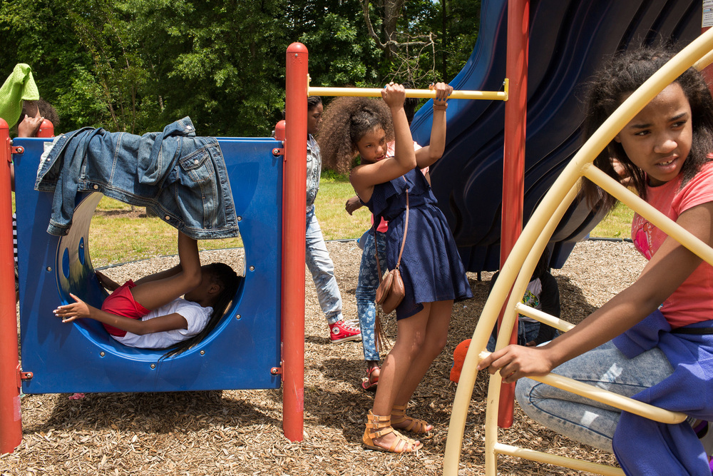 Fifth graders Karay Brevard, 11, (CENTER) and Laryah Goldsberry, 10, (FAR RIGHT) play on the playground Parkview Expressive Arts Magnet School in High Point, N.C.
