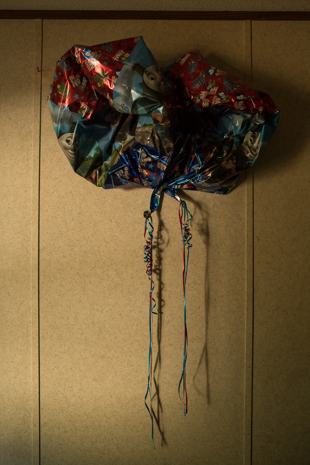 Deflated balloons in the trailer where Betty Mungin, 55; Alexis Mungin, 29 and her unborn twins; and Armani Mungin, 8 were shot and killed in May 2016.