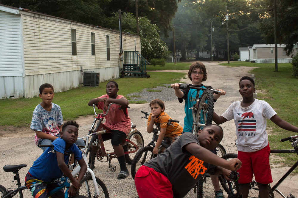 The neighborhood bike crew at Ravenel Mobile Home Park. They all miss riding bikes with Armani Mungin, 8.