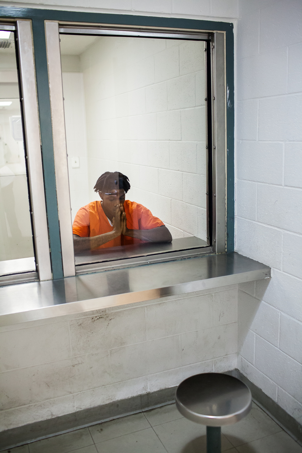 Rashard Johnson at the Durham County Detention Center after being arrested for cutting off his house arrest ankle monitor, violating his probation, and going on the run for two months. Without a GED or a job, Rashard couldn't repay his restitution and succumbed to frustration in 2012.