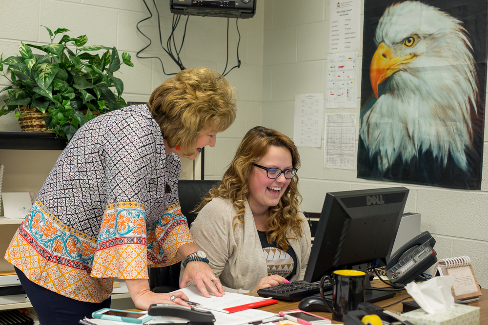 College Liaison Melanie Hudson helps senior Brianna Hemrich enroll in community college classes at Central Surry High School. Hudson works with students who are dual enrolled in Surry Community College classes to help promote a college-bound culture.
