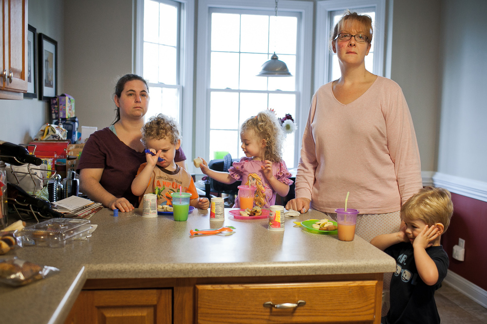 Karen Wade and Kelli Evans together for 17 years, and their 3-year-old triplets Evan, Emma and Grady in Durham, N.C. Personal work.