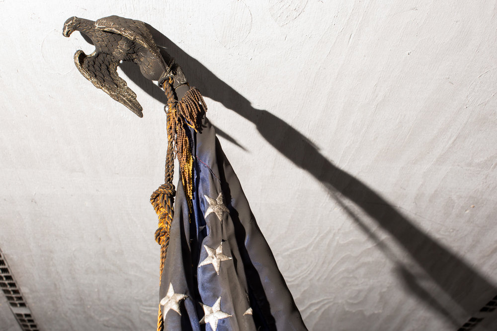 A singed and melted American flag at the   Orange County North Carolina Republican Party outside there their firebombed campaign office in Hillsborough, N.C.