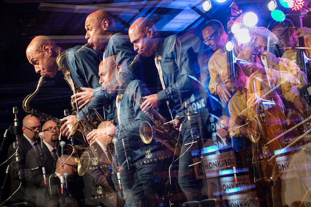 A 4-photo in-camera multiple exposure of Joshua Redman playing with the Ethan Iverson Trio during the Monk@100 festival, celebrating what would have been Thelonious Monk's 100th birthday, at the Durham Fruit and Produce Company in Durham, NC. For The New York Times