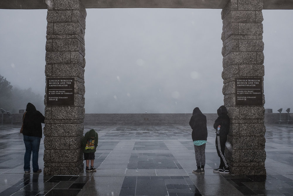 Mount Rushmore vanished by fog.