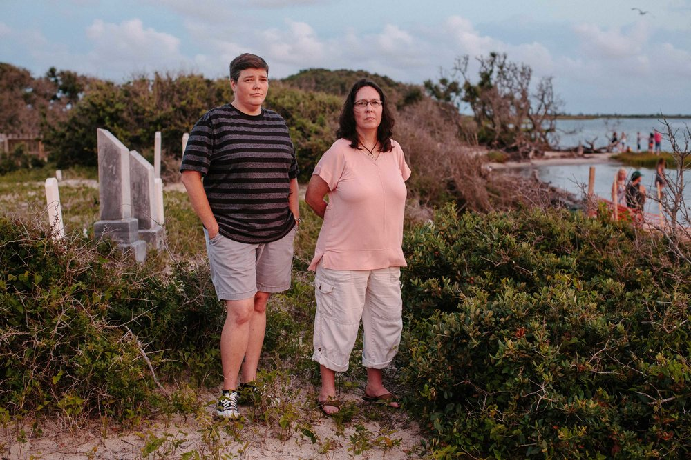 From left: Jenny Creech and Dawn Taylor both have kin buried in the Salvo Community Cemetery. Creech is president of the Hatteras Island Genealogical and Preservation Society, and Taylor is vice president. Their mission is to educate the public — especially tourists — and save the island's historical sites, structures and memories from being erased by humans, or by the sea. The Rodanthe-Waves-Salvo Civic Association appointed Creech to represent the cemetery descendants as the association works with the community, and state and federal agencies to build a permanent bulkhead between the sound and the cemetery, which would slow erosion. But time is running out.