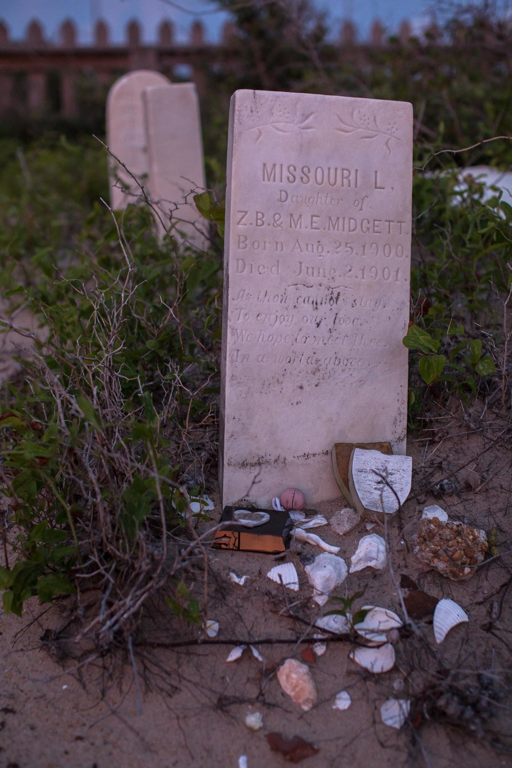 Tributes left behind on the grave of Missouri L. Midgett, who died at 10-months old in 1901.