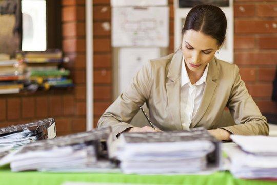 teacher-marking-office-157703235.min-535x360.jpg