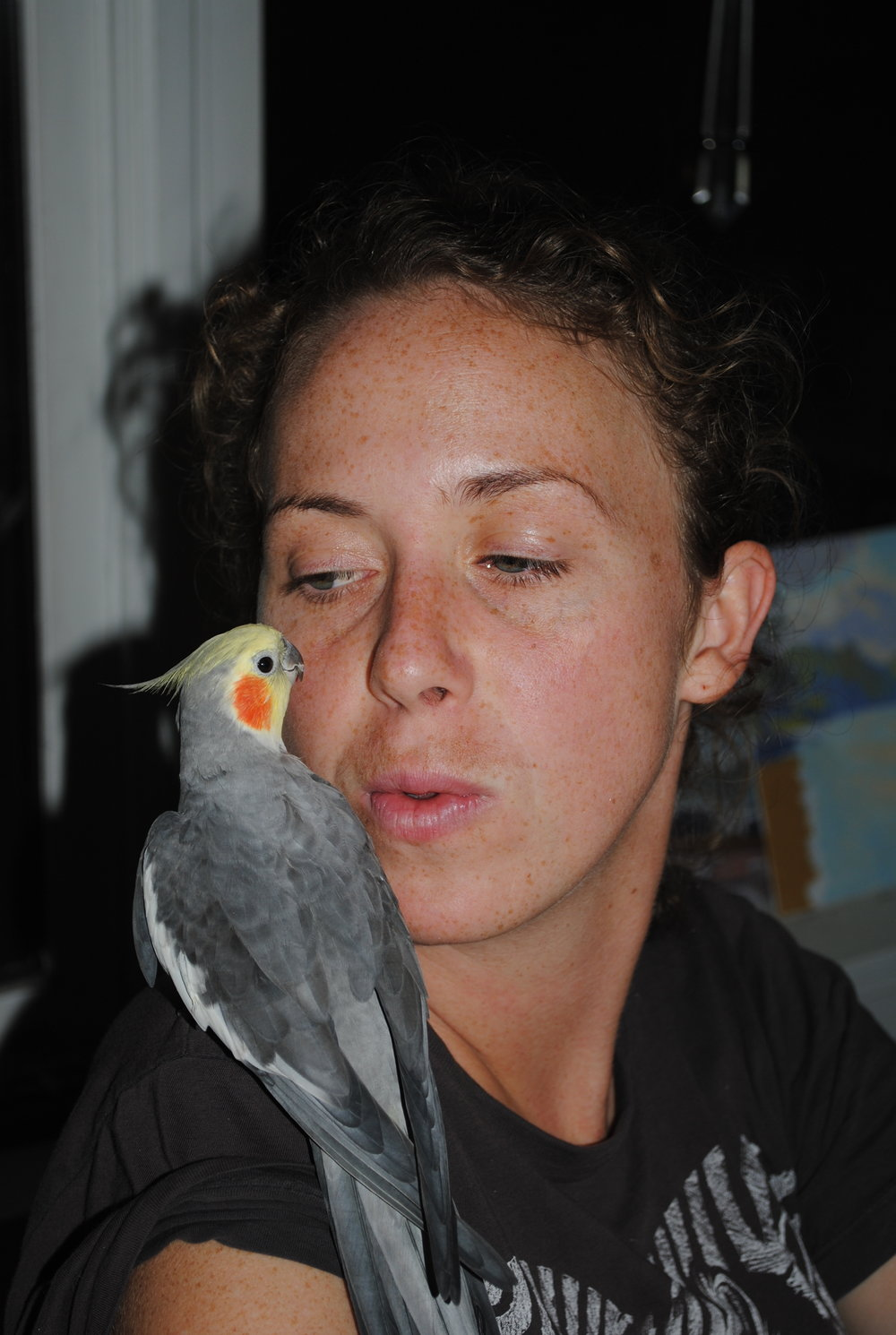 Margie with her bird Kiss       Hope it the thing with feathers      That perches in the soul      And sings the tune without the words      And never stops at all.           Emily Dickenson