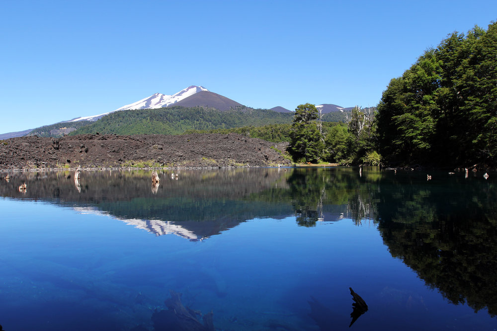 The Llaima volcano, reflected in Lake  Lake Arcoiris  in Conguillo National Park.