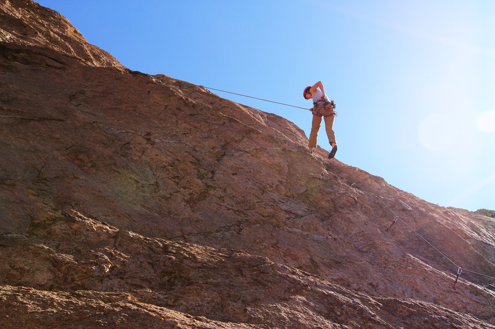 Jasmina completes a lead climb in Cochise, Arizona.