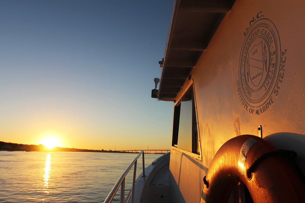 Watching the sunrise from the port side of the Capricorn, the largest research vessel operated by the UNC Institute of Marine Sciences.
