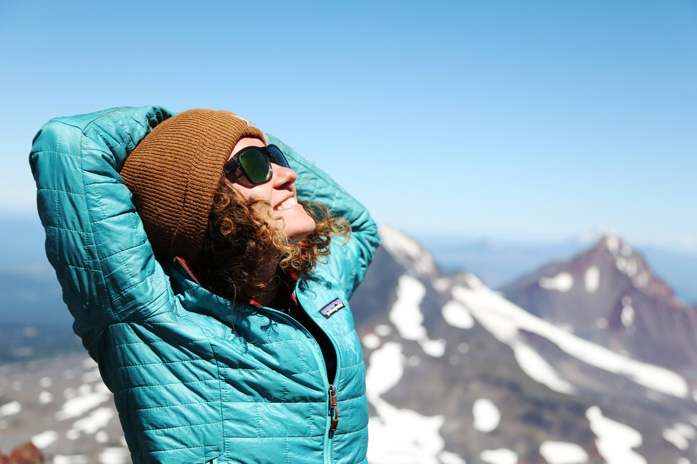 Smiling at the sun on the summit of South Sister in southern Oregon.