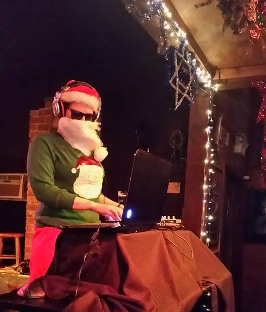 DJ Jenna Jordan throwing down tunes at NODA's first Ugly Sweater Holiday Party
