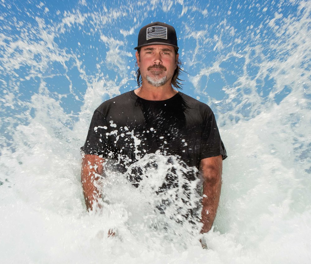 "Brent Broza Makes A Splash With His Photography Although Summer has officially ended, in most of SoCal, that is simply a matter of the calendar, not our lifestyles. For some, it is an ""Endless Summer,"" especially if you happen to be a surfer, or subscribe to that culture. For photographer Brent Broza, every day is about capturing the glory of our charmed climate. Broza is a self-taught photographer who grew up in Manhattan Beach surrounded by the surf and skateboard culture. His passion for art, sports, and music began at an early age. His parents were also photography buffs, chronicling his early days and adventures in those activities, an interest which was passed along to their precocious offspring. He began experimenting with film photography in 2004, but it would be years before he considered it more than hobby. As an artist heavily influenced by his earliest surroundings, most of Broza's photos involved landscapes, surf culture, musicians, and other artists. Eventually surfing took Broza on the road, from the South Bay, to a few years in Maui, looking for that perfect wave to ride, and other surfers to photograph. In Maui, he found himself with endless subject matter to shoot, from the astounding waves and pro surfers, to the dramatic and brilliant contrasting colors in the sunsets. One lucky day, he captured a photo of Aaron Gold on a Guinness World Record 63 foot wave in Maui, documented as being the largest wave ever to be paddled into by a surfer. The shot earned him the World Surf League's ""Biggest Paddle Award"" in 2016. His passion for surfing has taken him all over the world, and his surf shots have been featured in Surfer Magazine, Surfline, The Inertia and others. Now an award-winning photographer, it is his Rothko-inspired horizon line photography that is most distinctive and truly striking. A solo exhibit, ""In the Distance"" at the new Square Rhino Projects in Venice, CA features his dramatic and captivating new series. Featuring work from his Fireline and Serenity series in this exhibit, his photographs of blurred horizons are often mistaken for oil paintings, especially as they are printed on canvas. These color-field abstract photos of sunsets and sunrises capture brilliant striations of color in softly blurred images, invoking the sense of tranquility one often feels when standing on the shore of a favorite beach. Living near the ocean his whole life, it is no wonder that Broza has been able to capture such a serene spirit in his work.  The exhibit will be on view at Square Rhino Projects, 1510 Pacific Avenue, Venice CA from October 14th through November 11th, 2017. Gallery hours are Wednesday through Sunday, 11 AM – 4 PM. To attend the opening night Artist Reception on October 14th from 7-10 PM, please RSVP to PR@SquareRhinoPrpojects.com To see examples of his work and find more information on Brent Broza, please visit http://www.brozaphoto.com"