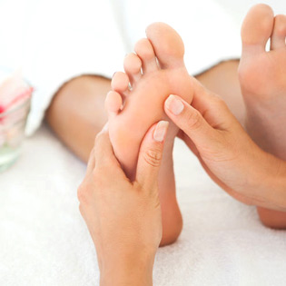 Podiatrist examines foot for injuries after an accident.