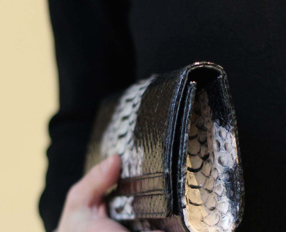 This python clutch features the belly of the snake on both the front and the side.