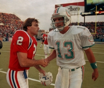 Flutie & Marino shake hands after a game in the 80's, not knowing what adventures lie ahead.