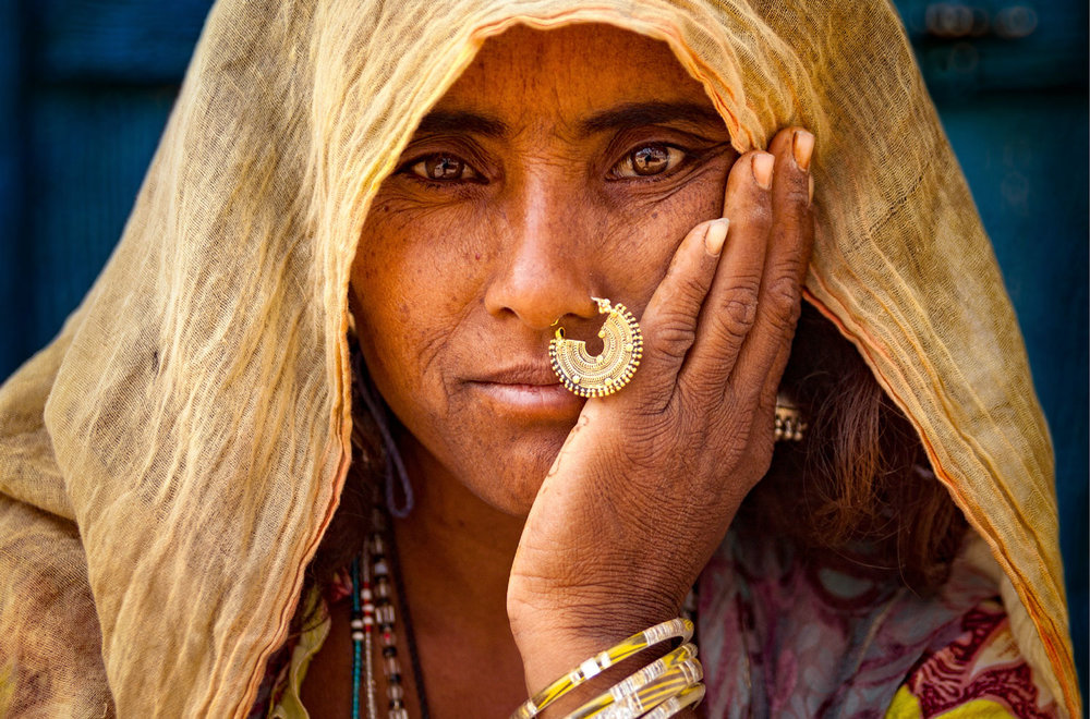 A Rajasthani woman wearing exquisite tribal jewelry