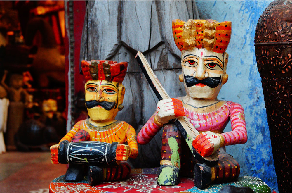 Handcrafted wooden puppets at a local market