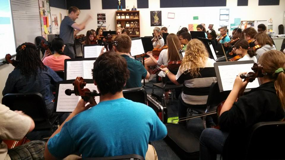 "Conducting ""The Swashbuckling Suite"" with the Summit Middle School Orchestra."