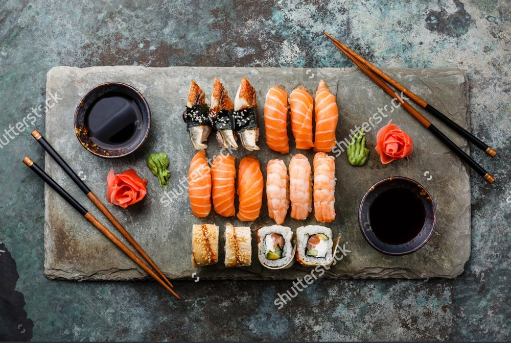 stock-photo-sushi-set-sashimi-and-sushi-rolls-served-on-stone-slate-366833861.jpg