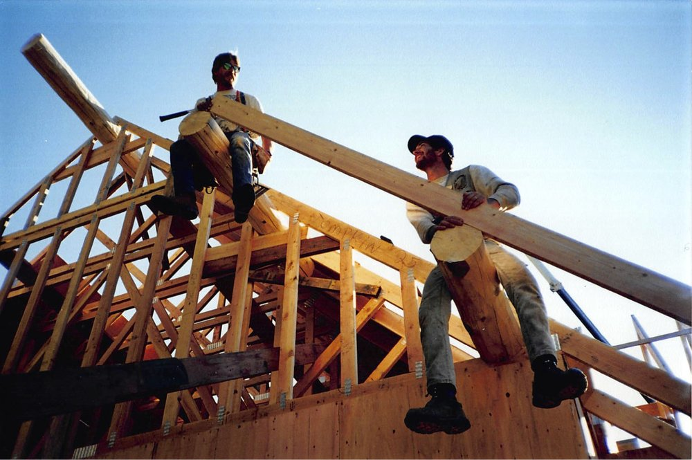 Two of the original builders working on framing the main lodge. C. 1994