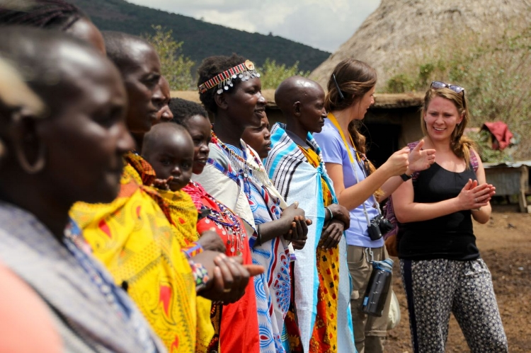 Joining the Maasai women in a song