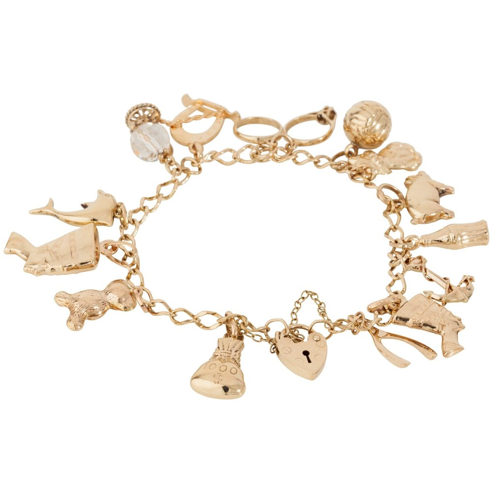 pre-owned-9ct-yellow-gold-charm-bracelet-with-assorted-charms-p23848-31527_zoom.jpg