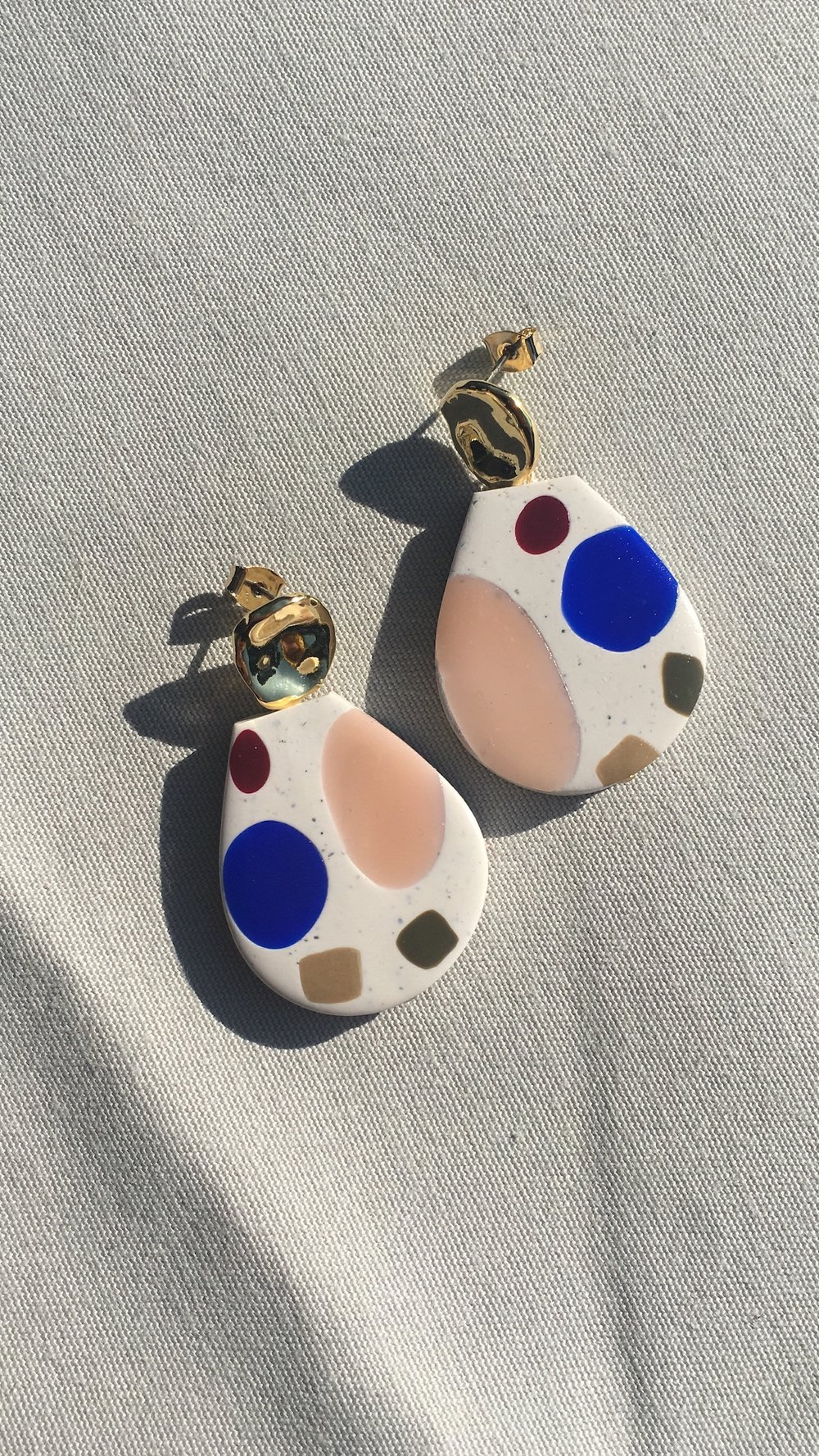 The Élan Earrings, a playful colour style with polished gold and sterling silver posts