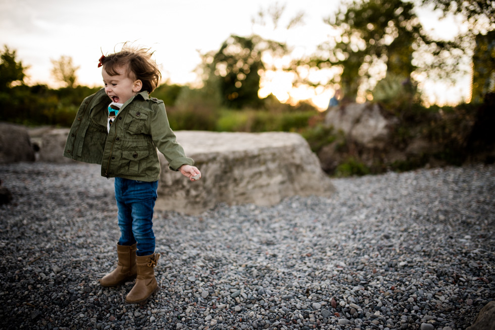little-girl-jumping-on-the-beach-at-humber-bay-by-jenny-diaz-toronto-family-lifestyle-photographer.jpg