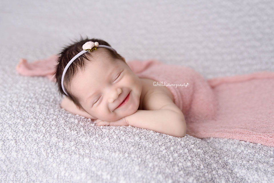 Smiling newborn - newborn photographer columbus ohio