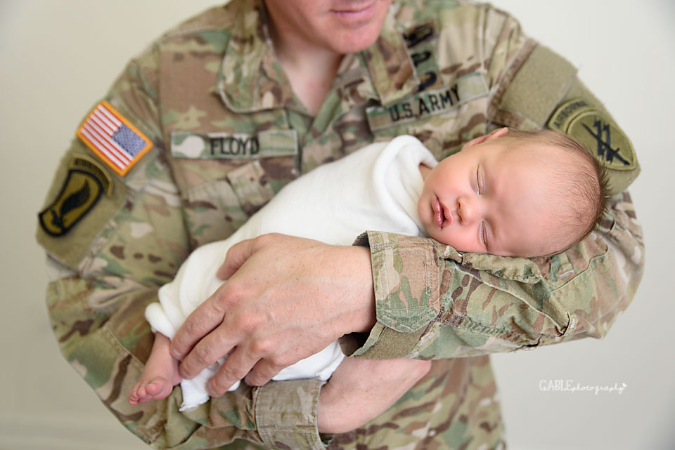 Army dad holding newborn