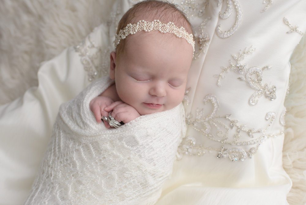 newborn-on-wedding-dress-portraits
