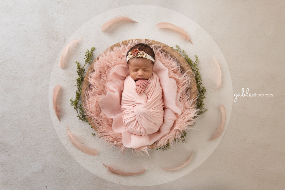 baby photographed in bowl