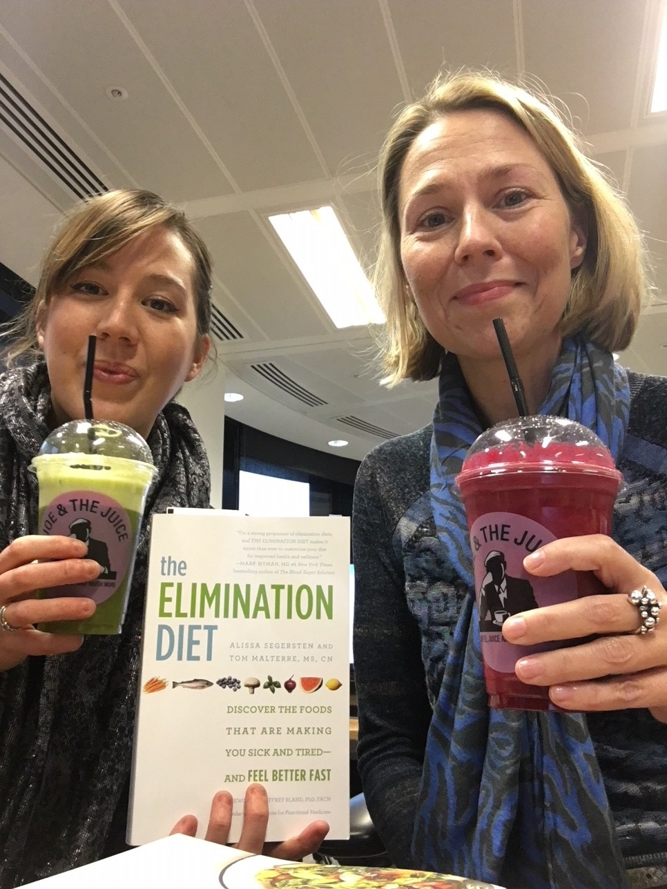 Amy and I with our juices on the first day (of detox)