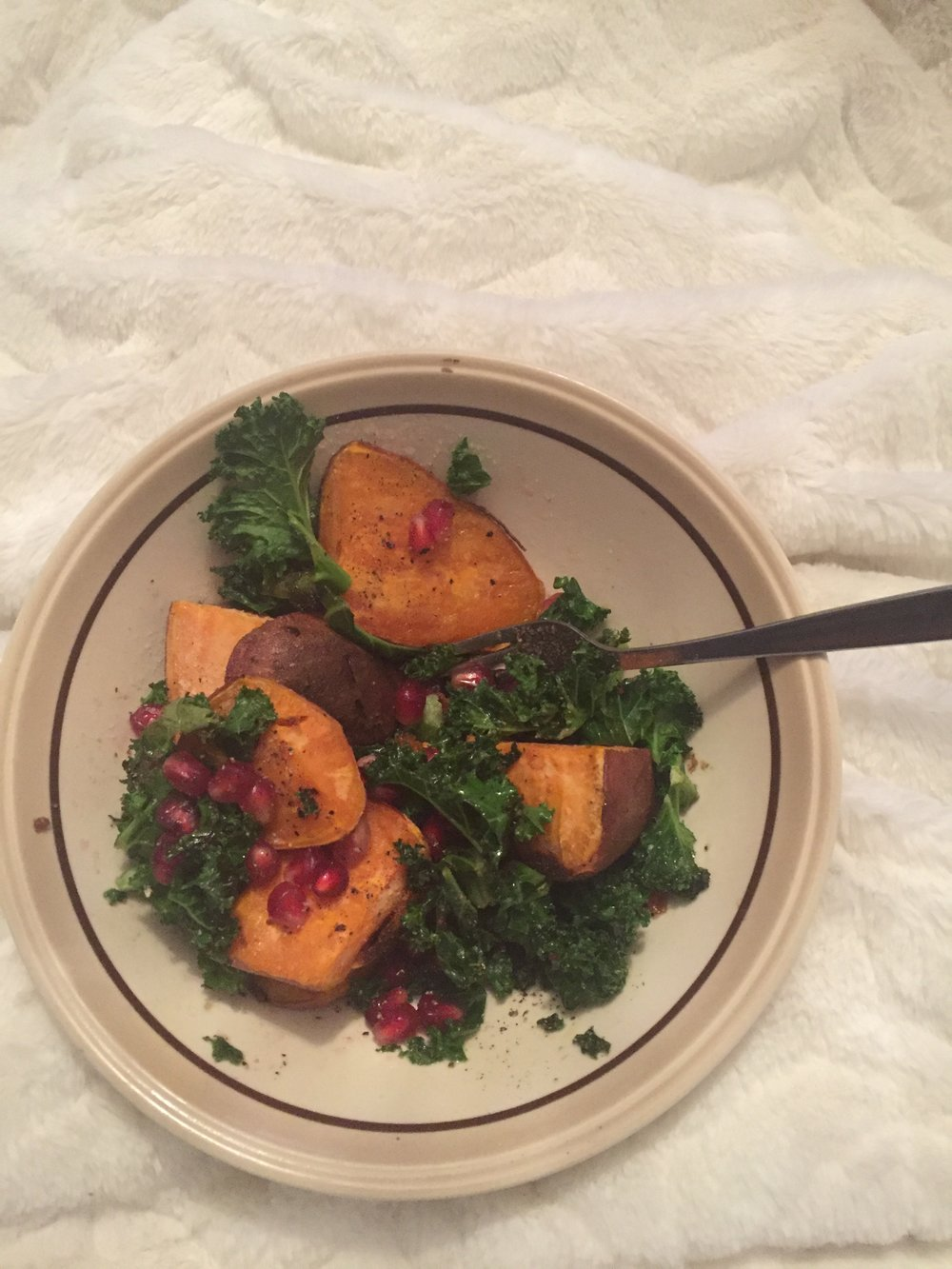 Amy's kale salad with sweet potato and pomegranate