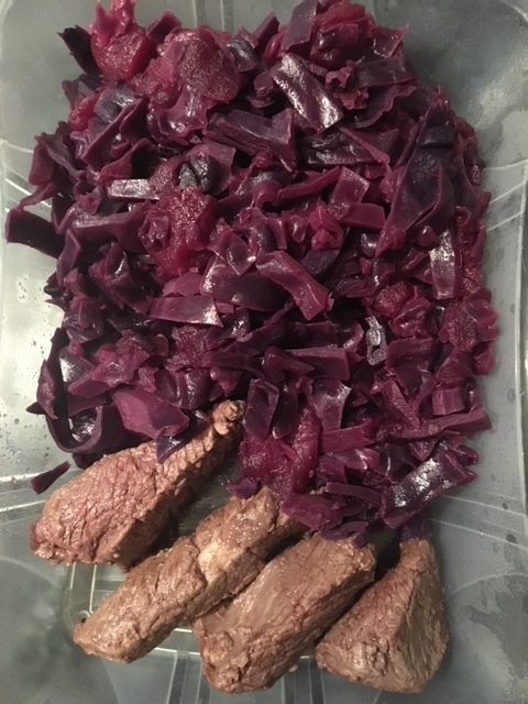 Lunch of red cabbage with apple and venison